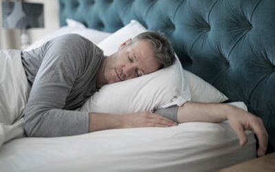 Man,Sleeping,On,Bed,In,Bedroom,At,Home